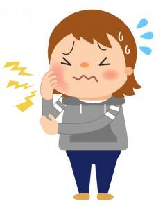 虫歯の治療に悩む妊娠初期の女性